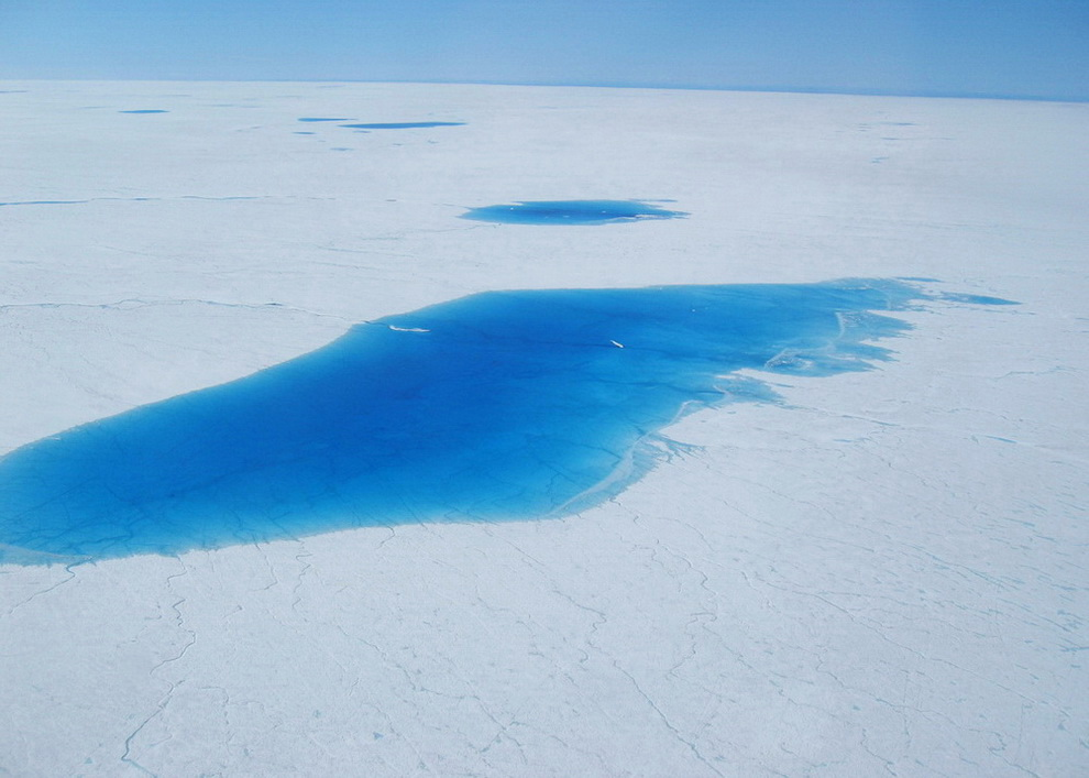 "The ""North Lake"" was the first site that was selected in 2006 for the deployment of scientific instruments for measuring changes in ice motion caused by melt water reaching the base of the ice sheet. The lake is only partially full in this picture. When entirely full, the lake was nearly 4-km (2.5 miles) wide and more than 40 feet deep. The entire lake drained in about 90 minutes 16 days after this picture was taken."