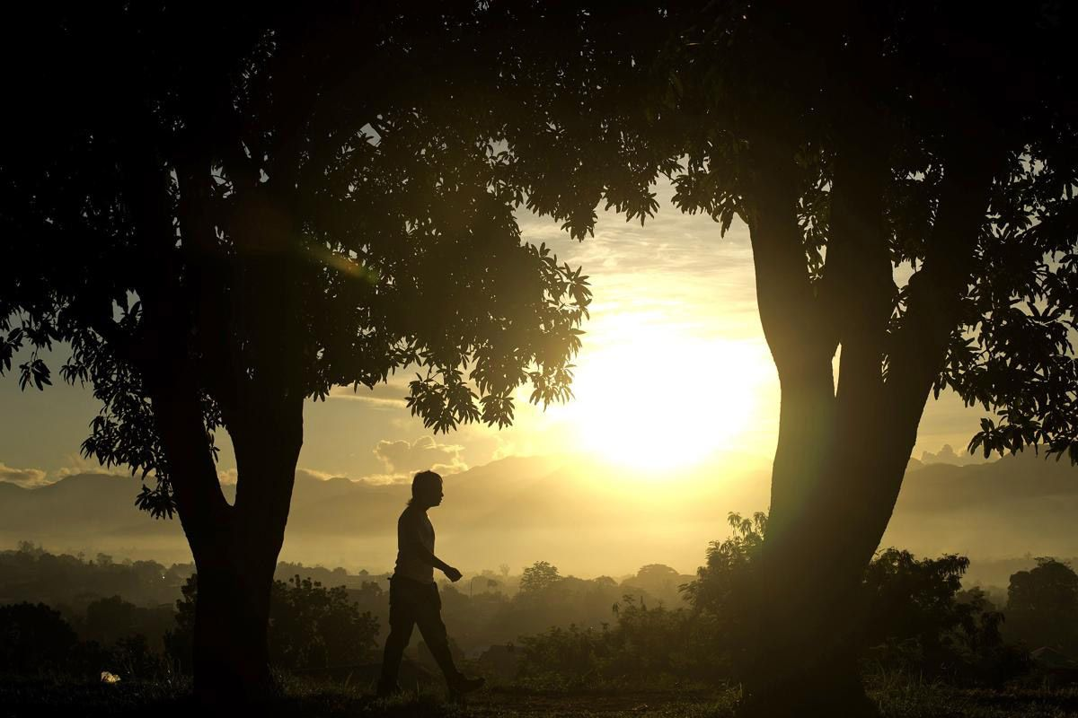 Закат. (Фото: NOEL CELIS)