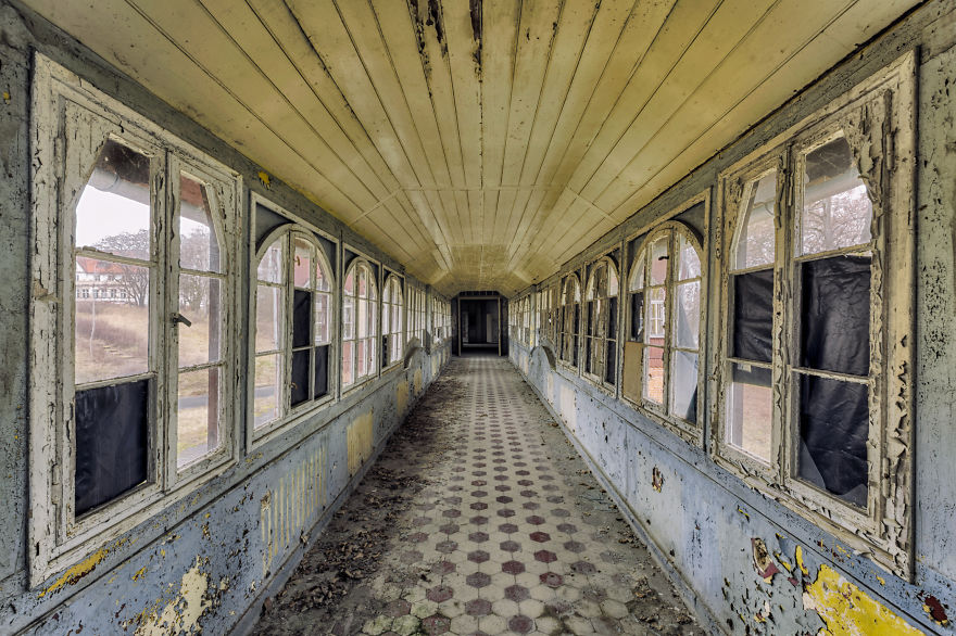 abandoned corridor in hospital with windows and doors