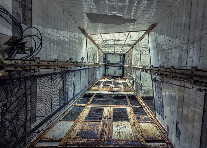 abandoned elevator in hospital with rusty doors