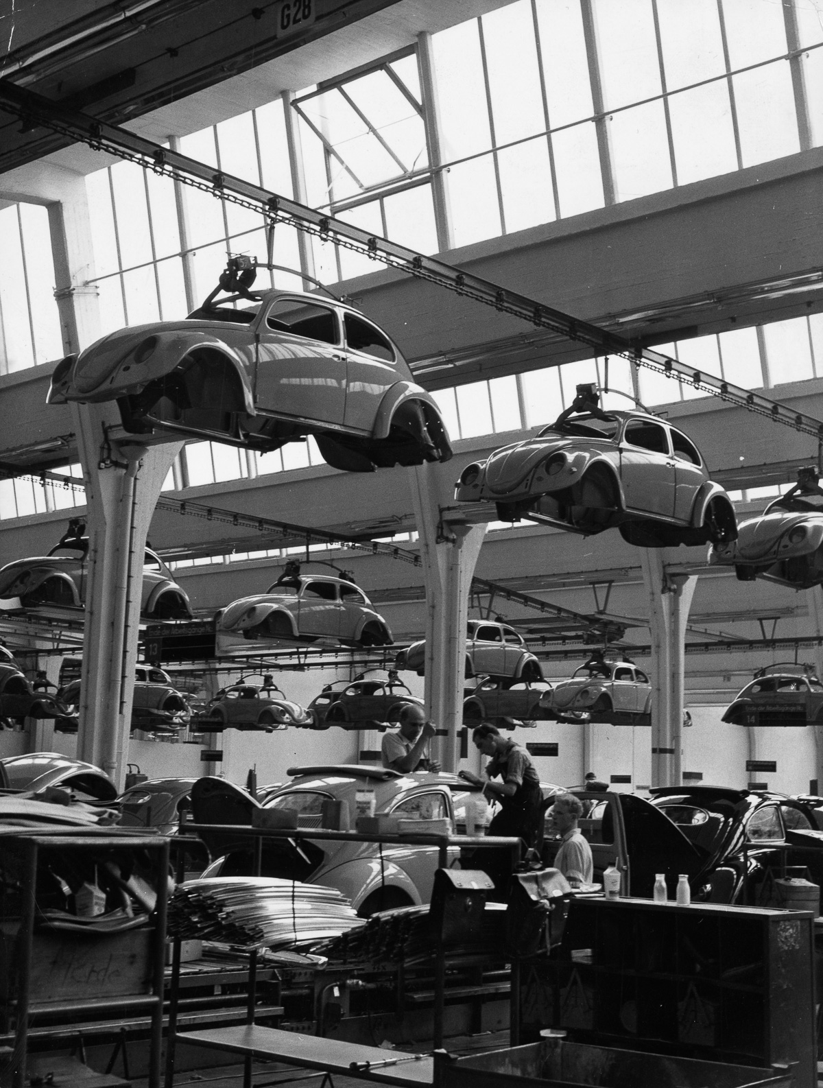 circa 1955: Workers on the production line of a Volkswagen factory at work on Beetles. (Photo by Keystone/Getty Images)