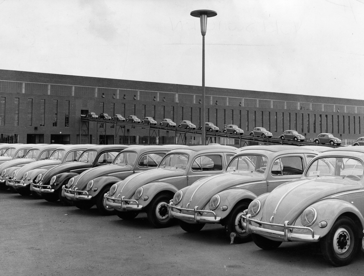 A line-up of brand new Volkswagen Beetle cars at the Wolfsburg factory. (Photo by Keystone Features/Getty Images)
