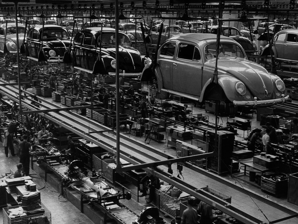26th September 1956: A production line manufacturing Volkswagen Beetles at the factory in Wolfsburg, West Germany. (Photo by Keystone Features/Getty Images)