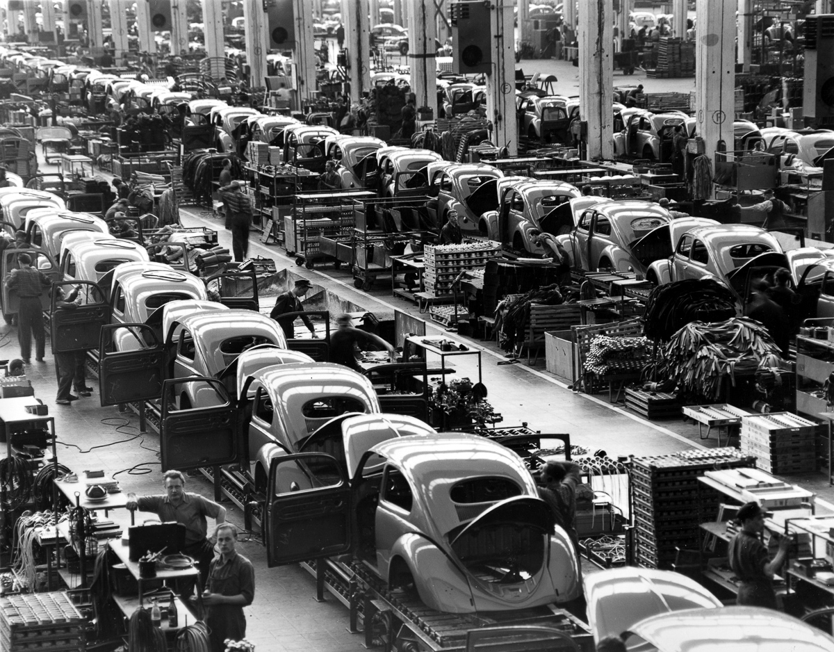 FILE - In this June 16, 1954 file photo, VW beetles are assembled in lines at the Volkwagen auto works plant, which manufactures nearly 900 automobiles each day, in Wolfsburg, West Germany. Thanks to Volkswagen, Wolfsburg boomed in West Germany's postwar rebirth and today the town and the company are inseparable. (AP Photo/Reithausen, File)