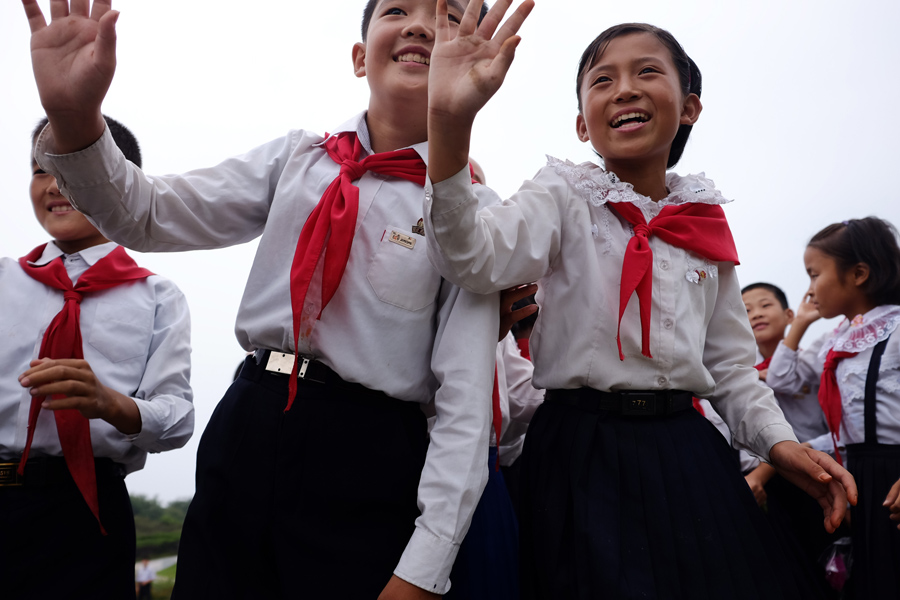 Школьники в Хамхыне, втором по величине городе в Северной Корее, 23 августа 2014 г.